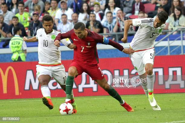 Cristiano Ronaldo of Portugal in action against Giovani Dos Santos end Diego Reyes of Mexico during the FIFA Confederations Cup 2017 group A soccer...