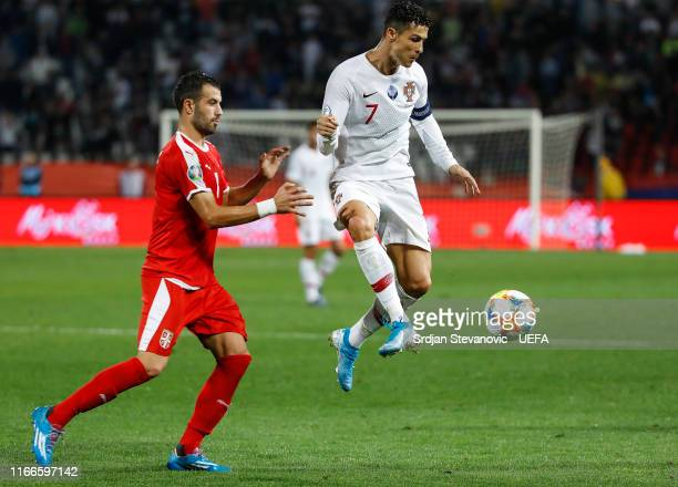 Cristiano Ronaldo of Portugal in action against Luka Milivojevic during the UEFA Euro 2020 qualifier between Serbia and Portugal at Stadium Crvena...
