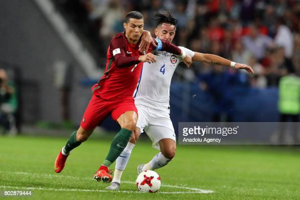 Cristiano Ronaldo of Portugal in action against Mauricio Isla of Chile during the FIFA Confederations Cup 2017 Semifinal soccer match between...