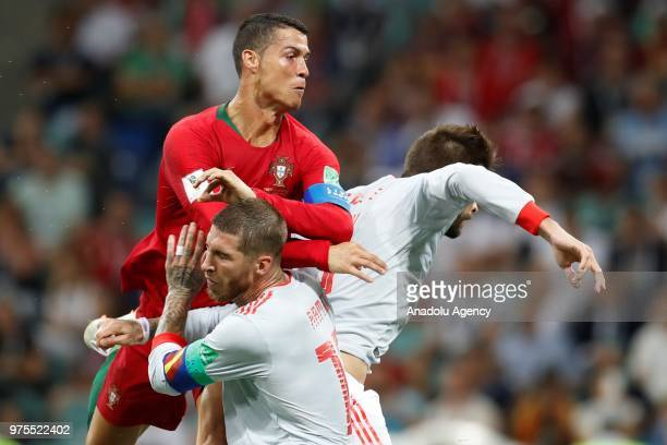 Cristiano Ronaldo of Portugal in action against Pique and Ramos of Spain during the 2018 FIFA World Cup Russia Group B match between Portugal and...