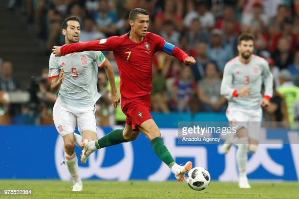 Cristiano Ronaldo of Portugal in action against Sergio Busquets of Spain during the 2018 FIFA World Cup Russia Group B match between Portugal and...