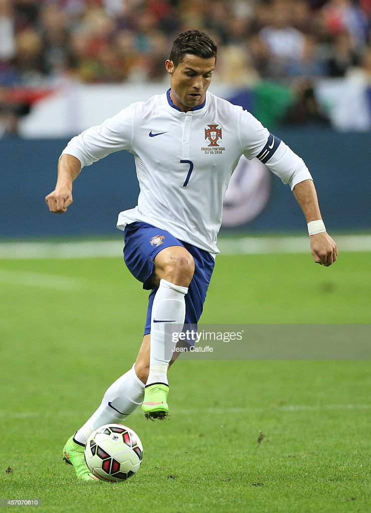 Cristiano Ronaldo of Portugal in action during the international friendly match between France and Portugal at Stade de France on October 11, 2014 in Saint-Denis near Paris, France.