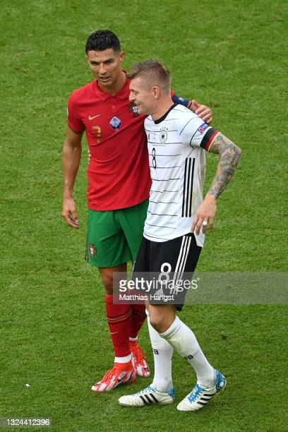Cristiano Ronaldo of Portugal interacts with Toni Kroos of Germany after the UEFA Euro 2020 Championship Group F match between Portugal and Germany...