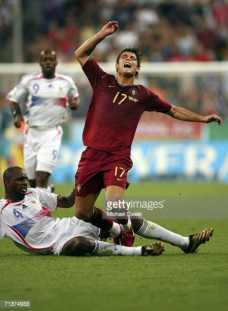 Cristiano Ronaldo of Portugal is brought down by the challenge from Patrick Vieira of France during the FIFA World Cup Germany 2006 Semifinal match...