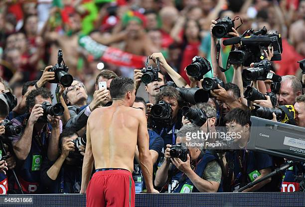 Cristiano Ronaldo of Portugal is centre of media attention as he celebrates winning at the final whistle during the UEFA EURO 2016 Final match...