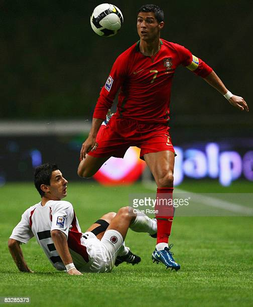 Cristiano Ronaldo of Portugal is challanged by Kristi Vangjeli of Albania during the FIFA2010 Group One World Cup Qualifying match between Portugal...
