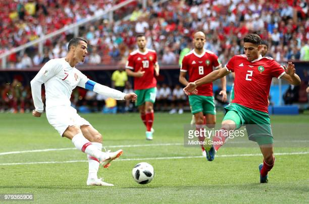 Cristiano Ronaldo of Portugal is challenged by Bruno Alves of Portugal during the 2018 FIFA World Cup Russia group B match between Portugal and...