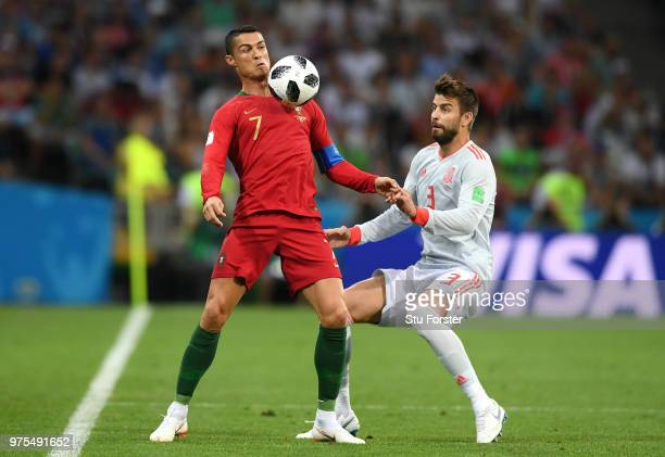 Cristiano Ronaldo of Portugal is challenged by Gerard Pique of Spain during the 2018 FIFA World Cup Russia group B match between Portugal and Spain...