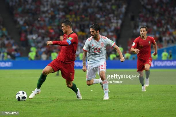 Cristiano Ronaldo of Portugal is challenged by Isco of Spain during the 2018 FIFA World Cup Russia group B match between Portugal and Spain at Fisht...