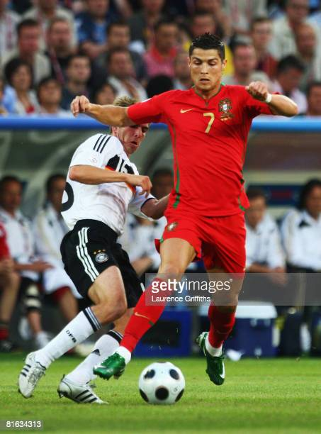 Cristiano Ronaldo of Portugal is challenged by Philipp Lahm of Germany during the UEFA EURO 2008 Quarter Final match between Portugal and Germany at...