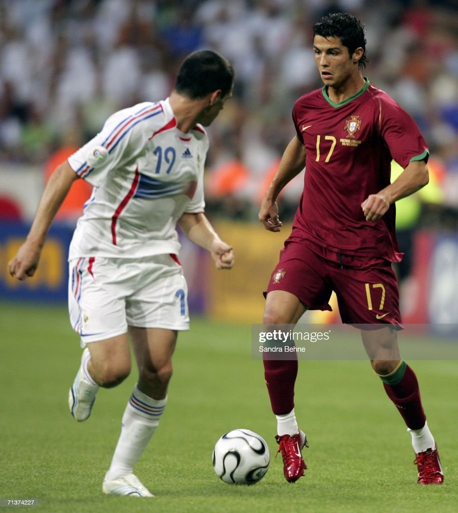 Cristiano Ronaldo of Portugal is challenged by Willy ...