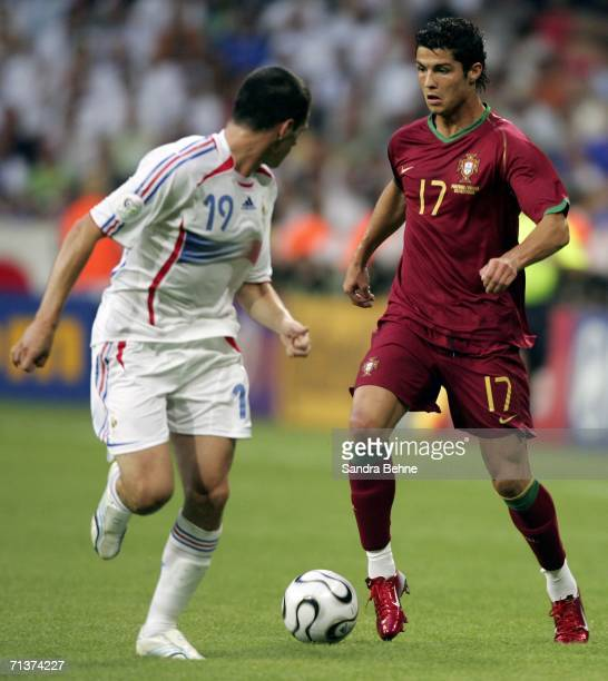 Cristiano Ronaldo of Portugal is challenged by Willy Sagnol of France during the FIFA World Cup Germany 2006 Semifinal match between Portugal and...