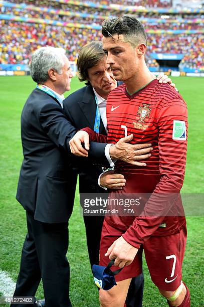 Cristiano Ronaldo of Portugal is consoled after the 2014 FIFA World Cup Brazil Group G match between Portugal and Ghana at Estadio Nacional on June...