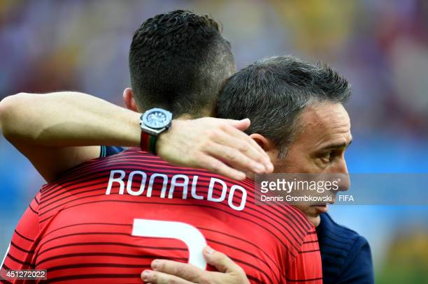 Cristiano Ronaldo of Portugal is consoled by coach Paulo Bento of Portugal after the 2014 FIFA World Cup Brazil Group G match between Portugal and...