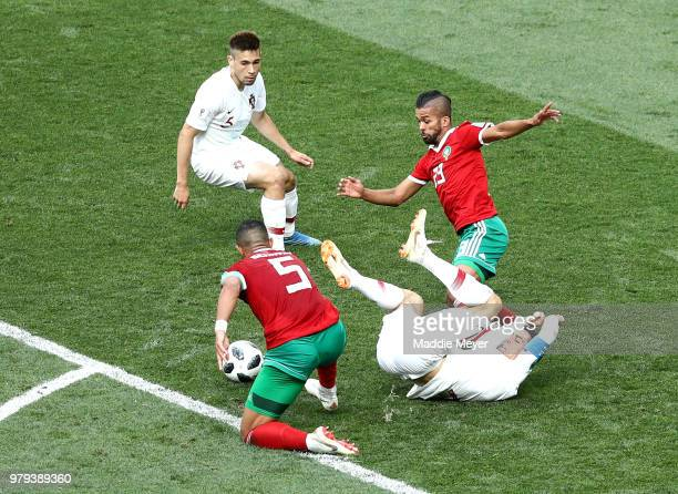 Cristiano Ronaldo of Portugal is fouled by Mehdi Benatia of Morocco just outside the box during the 2018 FIFA World Cup Russia group B match between...