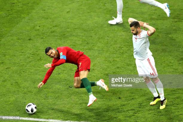 Cristiano Ronaldo of Portugal is fouled by Nacho of Spain leading to a penalty during the 2018 FIFA World Cup Russia group B match between Portugal...