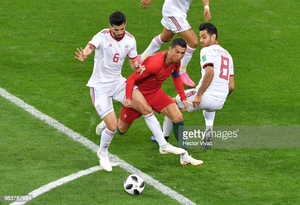 Cristiano Ronaldo of Portugal is fouled inside the box by Saeid Ezatolahi of Iran and gains a penalty during the 2018 FIFA World Cup Russia group B...