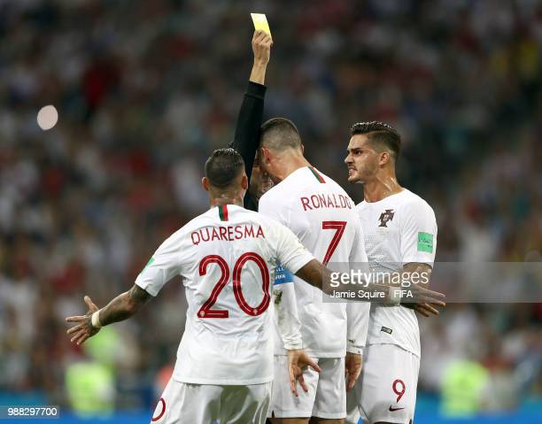 Cristiano Ronaldo of Portugal is given a yellow card during the final minutes of the 2018 FIFA World Cup Russia Round of 16 match between Uruguay and...