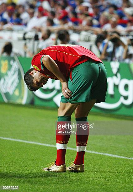 Cristiano Ronaldo of Portugal is injured during the UEFA Euro 2004 Group A match between Russia and Portugal at the Luz Stadium on June 16 2004 in...