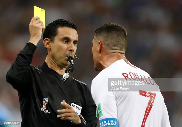 Cristiano Ronaldo of Portugal is shown a yellow card by referee Cesar Ramos during the 2018 FIFA World Cup Russia Round of 16 match between Uruguay...