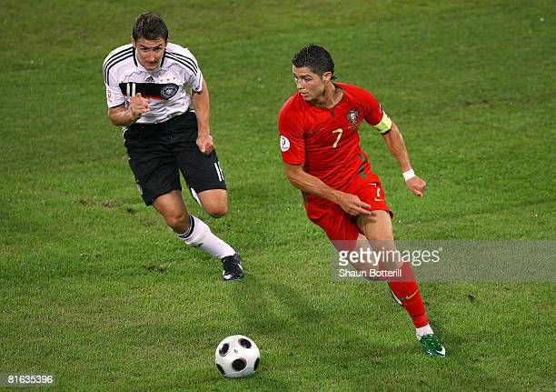 Cristiano Ronaldo of Portugal is shut down by Miroslav Klose of Germany during the UEFA EURO 2008 Quarter Final match between Portugal and Germany at...