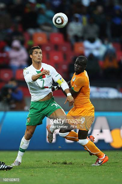 Cristiano Ronaldo of Portugal is tackled by Ismael Tiote of Ivory Coast during the 2010 FIFA World Cup South Africa Group G match between Ivory Coast...
