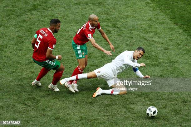 Cristiano Ronaldo of Portugal is tackled by Mehdi Benatia and Karim El Ahmadi of Morocco during the 2018 FIFA World Cup Russia group B match between...