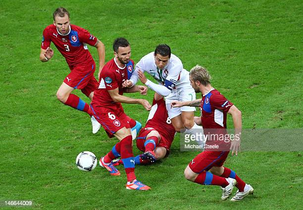 Cristiano Ronaldo of Portugal is tackled by Tomas Sivok and David Limbersky of Czech Republic during the UEFA EURO 2012 quarter final match between...