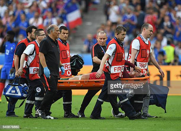 Cristiano Ronaldo of Portugal is taken off by a stretcher during the UEFA EURO 2016 Final match between Portugal and France at Stade de France on...