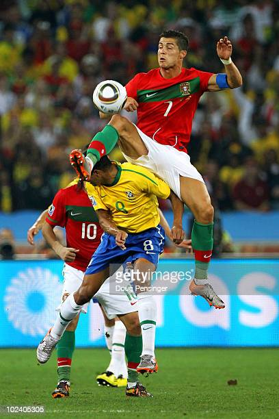Cristiano Ronaldo of Portugal jumps above Gilberto Silva of Brazil for the ball during the 2010 FIFA World Cup South Africa Group G match between...