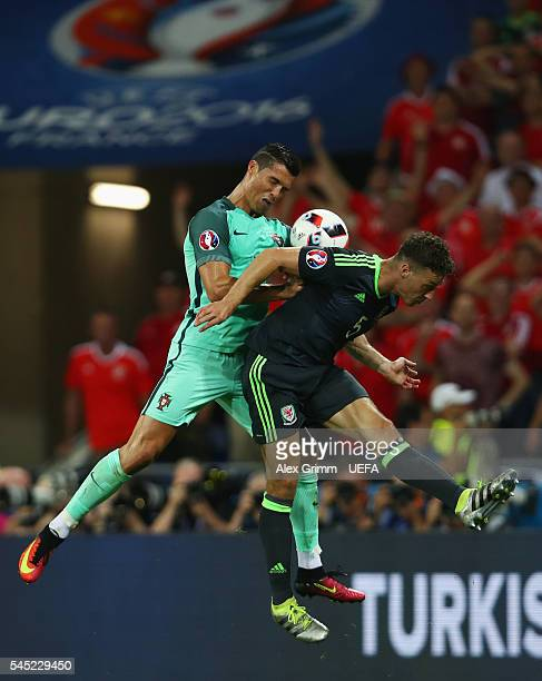 Cristiano Ronaldo of Portugal jumps for a header with James Chester of Wales during the UEFA EURO 2016 semi final match between Portugal and Wales at...