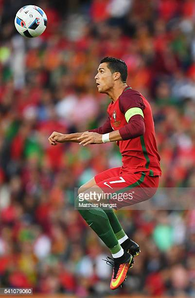 Cristiano Ronaldo of Portugal jumps to win a header during the UEFA EURO 2016 Group F match between Portugal and Austria at Parc des Princes on June...