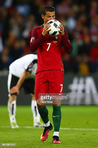 Cristiano Ronaldo of Portugal kisses the ball before he takes a penalty during the UEFA EURO 2016 Group F match between Portugal and Austria at Parc...