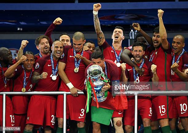 Cristiano Ronaldo of Portugal kisses the Henri Delaunay trophy after his side win 10 against France during the UEFA EURO 2016 Final match between...