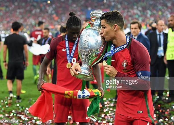 Cristiano Ronaldo of Portugal kisses the Henri Delaunay trophy to celebrate after their 10 win against France in the UEFA EURO 2016 Final match...