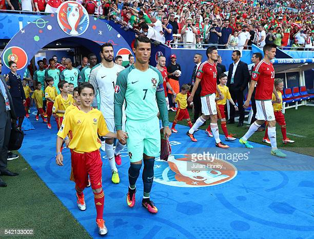 Cristiano Ronaldo of Portugal leads his team mate prior to the UEFA EURO 2016 Group F match between Hungary and Portugal at Stade des Lumieres on...