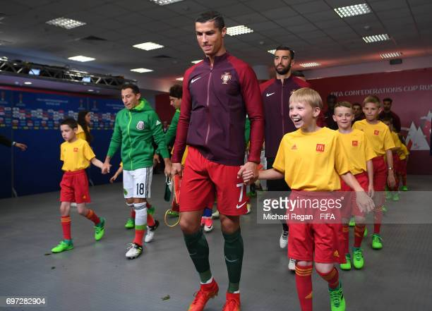 Cristiano Ronaldo of Portugal leads his team out prior to the FIFA Confederations Cup Russia 2017 Group A match between Portugal and Mexico at Kazan...