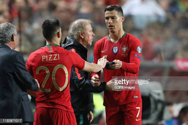 Cristiano Ronaldo of Portugal leaves injured and gives the captain's bracelet to Pizzi of Portugal during the Qualifiers Group B to Euro 2020...