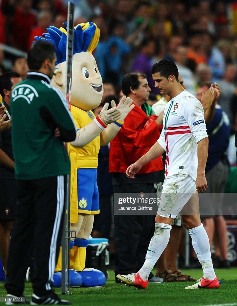 Cristiano Ronaldo of Portugal leaves the pitch dejected after losing a penalty shoot out during the UEFA EURO 2012 semi final match between Portugal and Spain at Donbass Arena on June 27, 2012 in Donetsk, Ukraine.