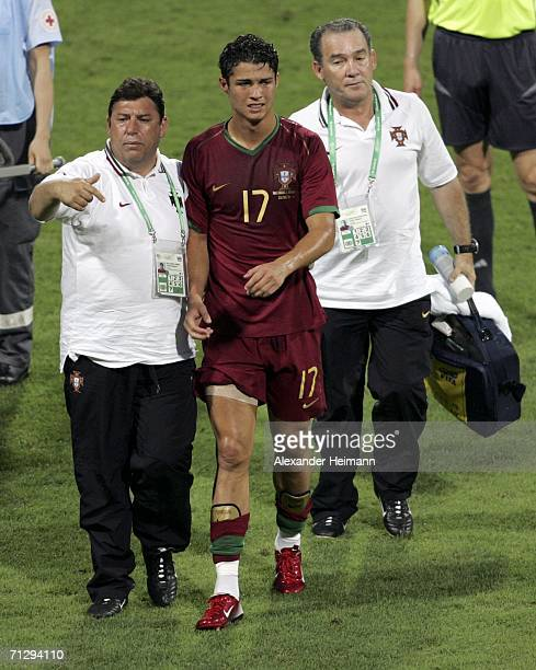Cristiano Ronaldo of Portugal, leaves the pitch in the first half after receiving an injury during the FIFA World Cup Germany 2006 Round of 16 match...