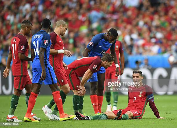 Cristiano Ronaldo of Portugal lies injured during the UEFA EURO 2016 Final match between Portugal and France at Stade de France on July 10 2016 in...