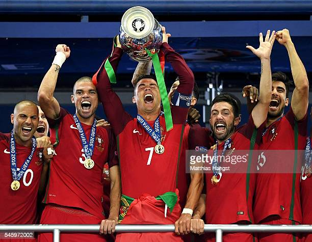 Cristiano Ronaldo of Portugal lifts the Henri Delaunay trophy after his side win 1-0 against France during the UEFA EURO 2016 Final match between...
