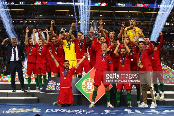 Cristiano Ronaldo of Portugal lifts the trophy following the UEFA Nations League Final between Portugal and the Netherlands at Estadio do Dragao on...