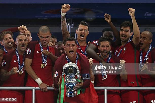 Cristiano Ronaldo of Portugal lifts the trophy following the UEFA Euro 2016 Final match between Portugal and France at Stade de France on July 10...