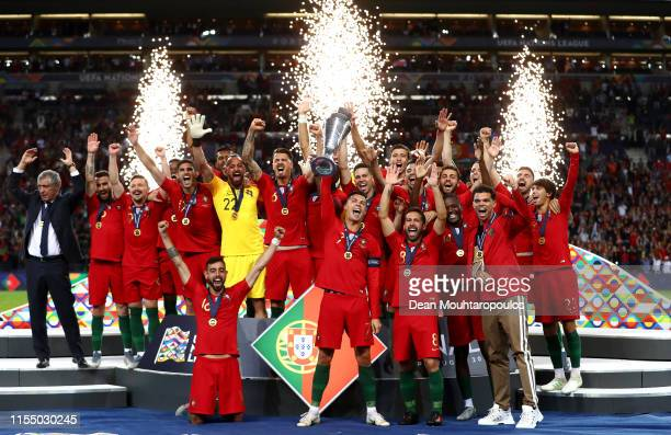 Cristiano Ronaldo of Portugal lifts the trophy with the squad and staff as he celebrates the victory and winning the UEFA Nations League Final...