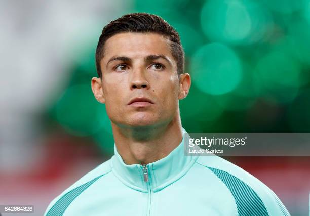 Cristiano Ronaldo of Portugal listens to the anthems prior to the FIFA 2018 World Cup Qualifier match between Hungary and Portugal at Groupama Arena...