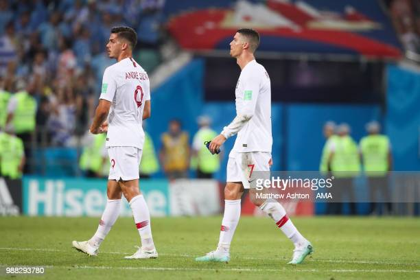 Cristiano Ronaldo of Portugal looks dejected with Andre Silva of Portugal at the end of the 2018 FIFA World Cup Russia Round of 16 match between...