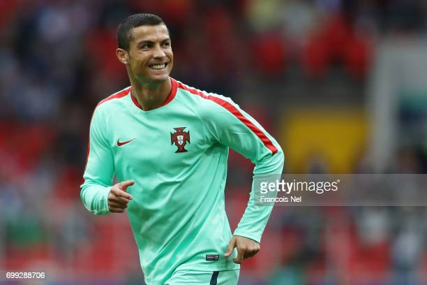 Cristiano Ronaldo of Portugal looks on while warming up prior to the FIFA Confederations Cup Russia 2017 Group A match between Russia and Portugal at...