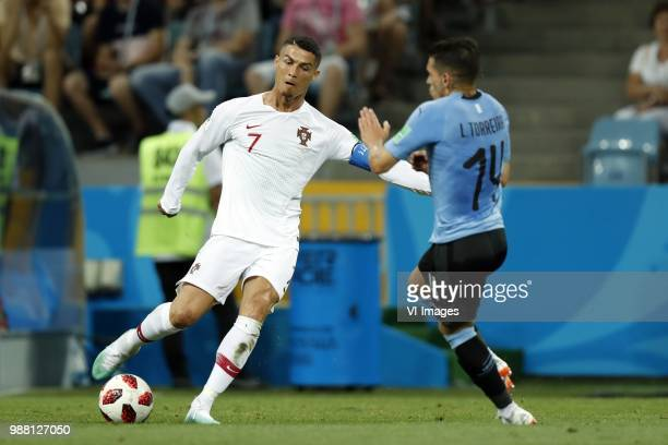 Cristiano Ronaldo of Portugal Lucas Torreira of Uruguay during the 2018 FIFA World Cup Russia round of 16 match between Uruguay and at the Fisht...