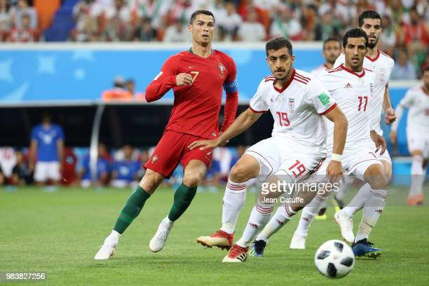 Cristiano Ronaldo of Portugal Majid Hosseini Vahid Amiri of Iran during the 2018 FIFA World Cup Russia group B match between Iran and Portugal at...